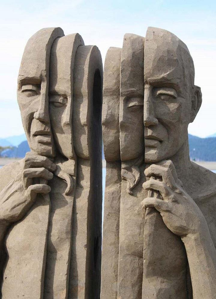 Carl Jara - faces sand sculpture